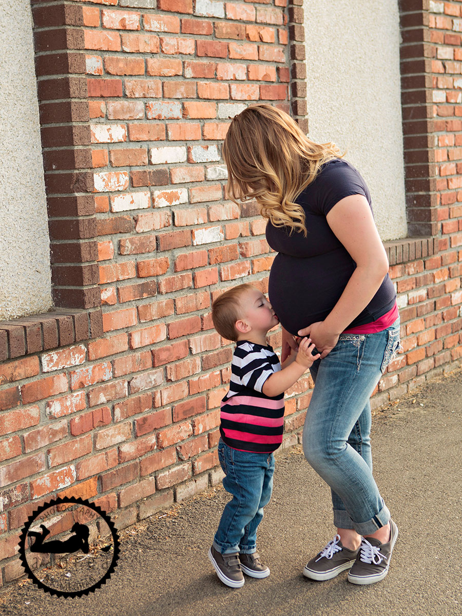 Brother kissing belly Kennewick, WA Maternity Photographer Adored by Meghan photography