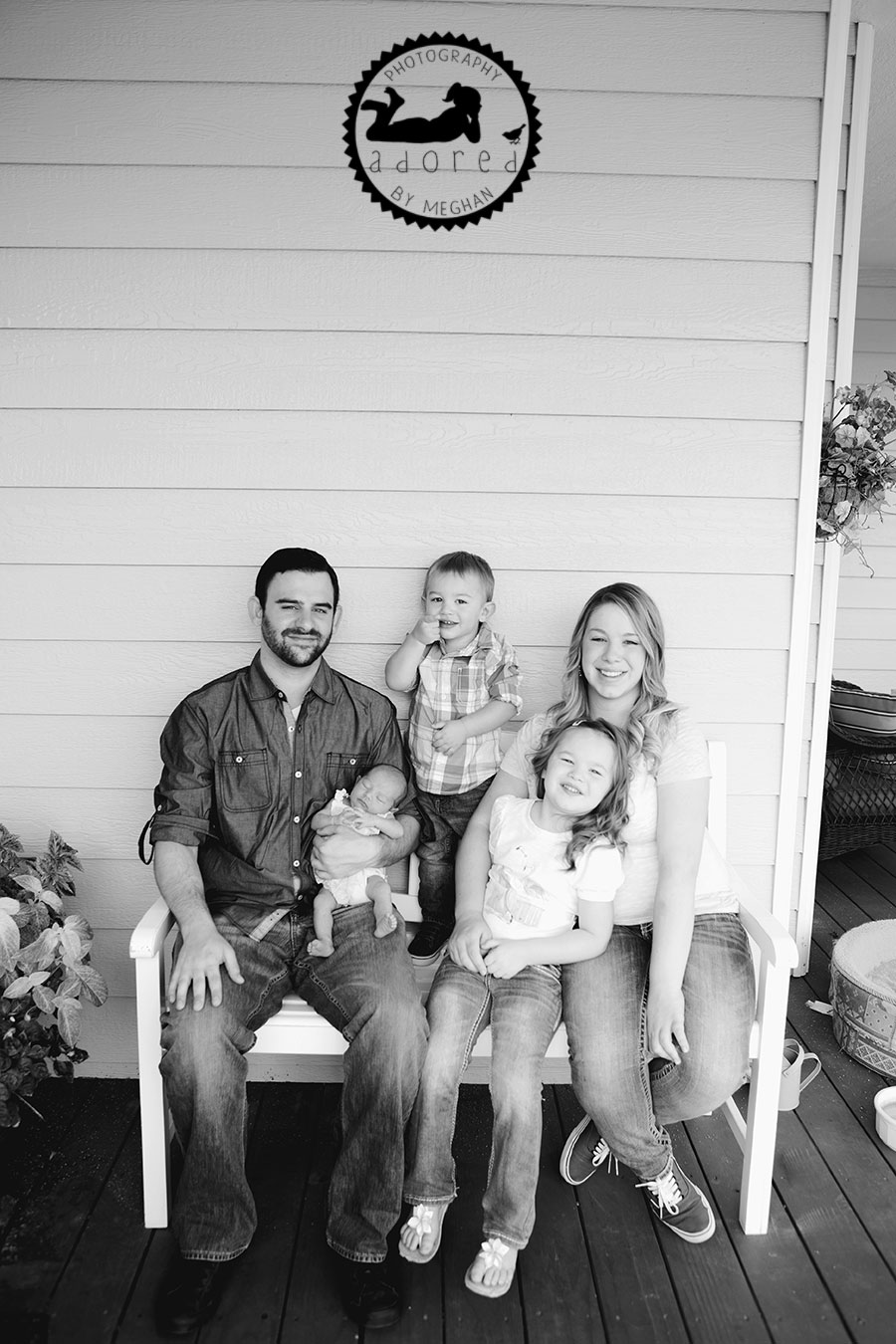 B&W Family on porch Newborn photographer adored by meghan rickard