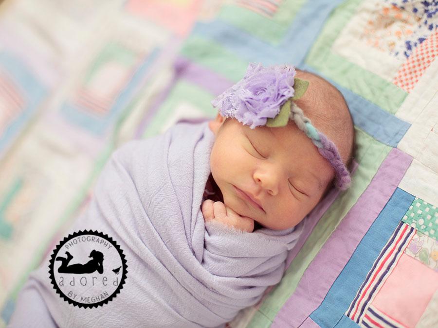 Girl purple on quilt Newborn photographer adored by meghan rickard