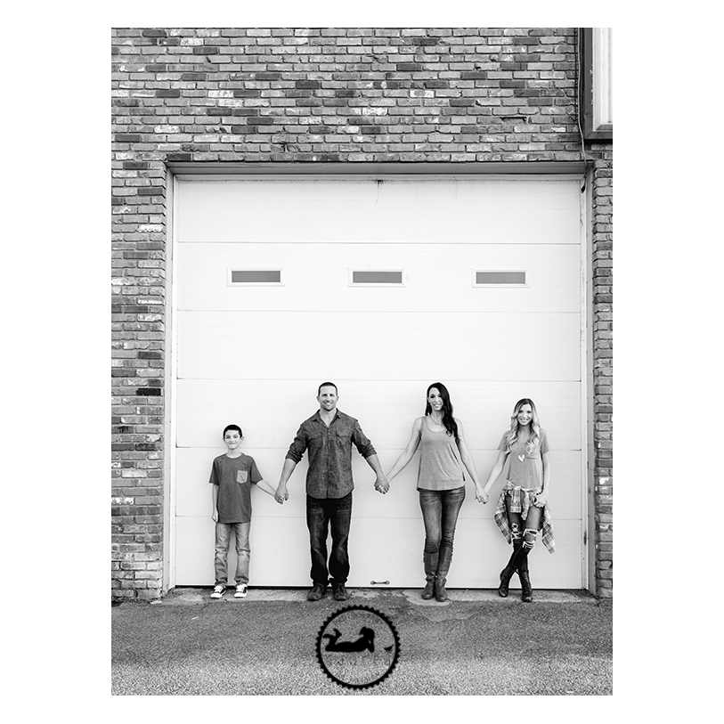 Downtown Kennewick Family photos with garage door. Portraits by Adored by Meghan