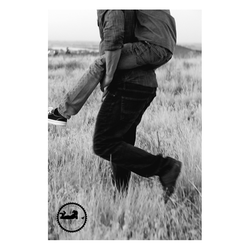 Black and white portrait of a Dad carrying his Son, piggyback style. Intentional Portraits. Adored by Meghan Rickard photography in Tri-Cities, WA