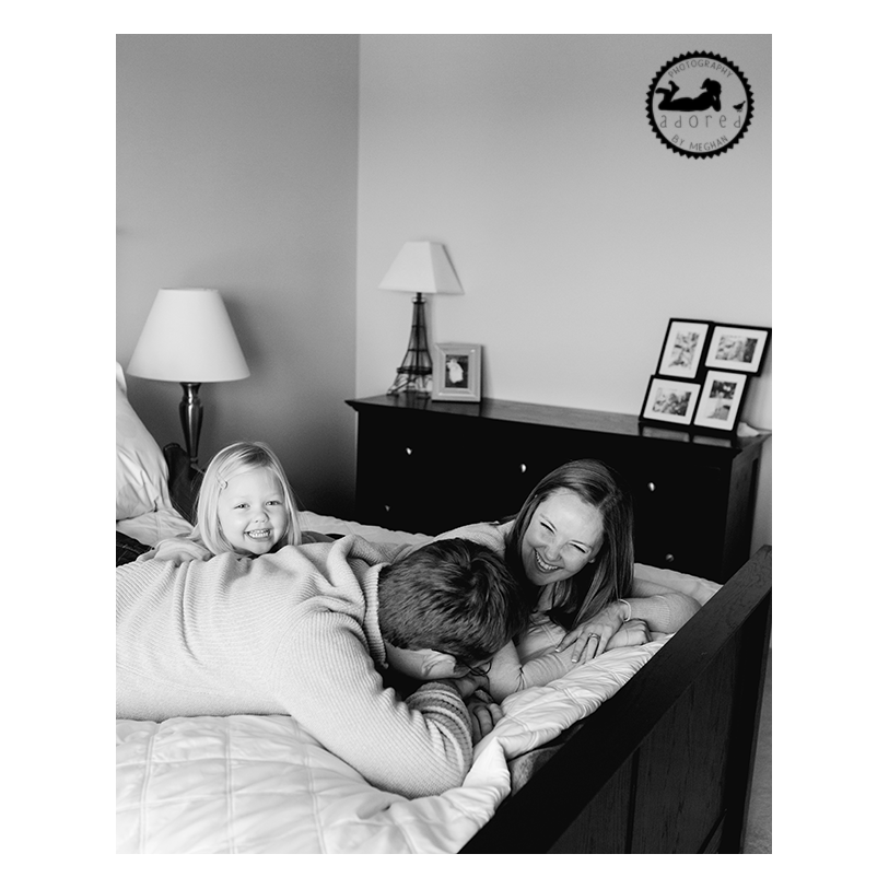 2015 Black & White Favorite Family Photo tickles for Mom & Dad on the bed, lifestyle in-home portrait session