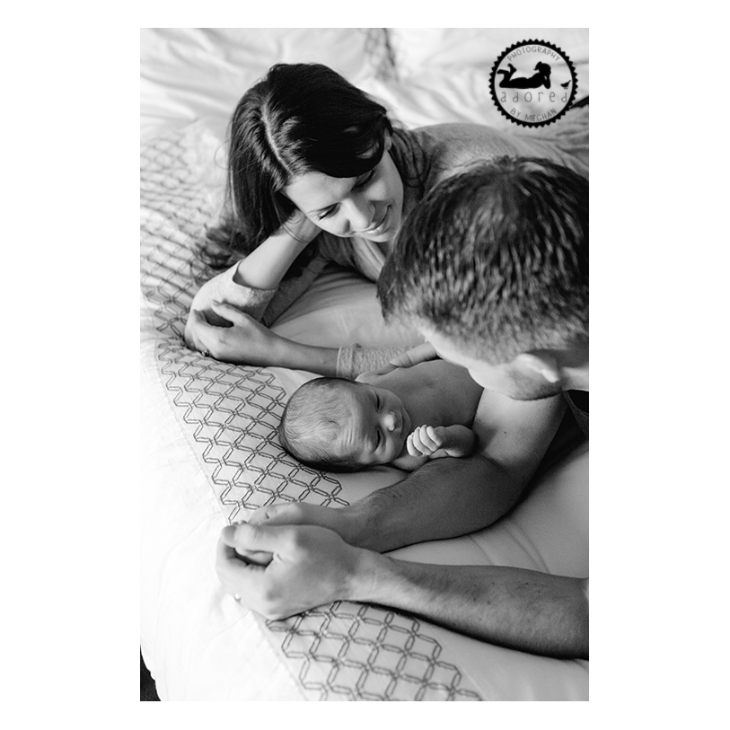 2015 Black & White Favorite Family Photo newborn with Mom & Dad on bed, lifestyle in-home portrait session