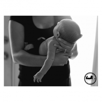 2015 Black & White Newborn Favorite Motherhood Adored holding baby details