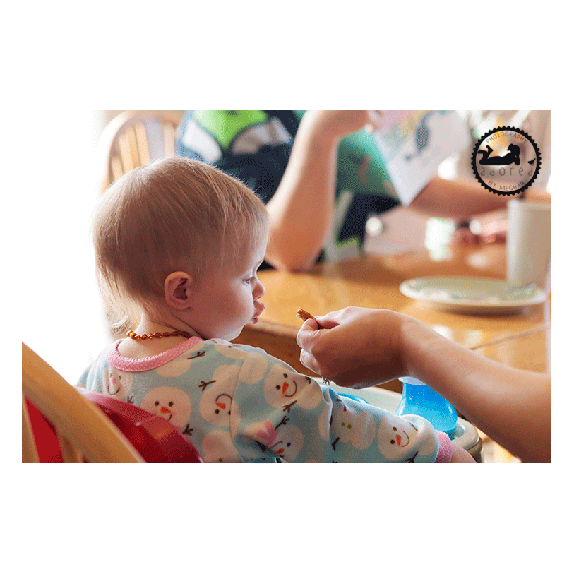 Adorable baby duck lips during breakfast. Lifestyle in-home family session with Adored by Meghan in Kennewick, WA.