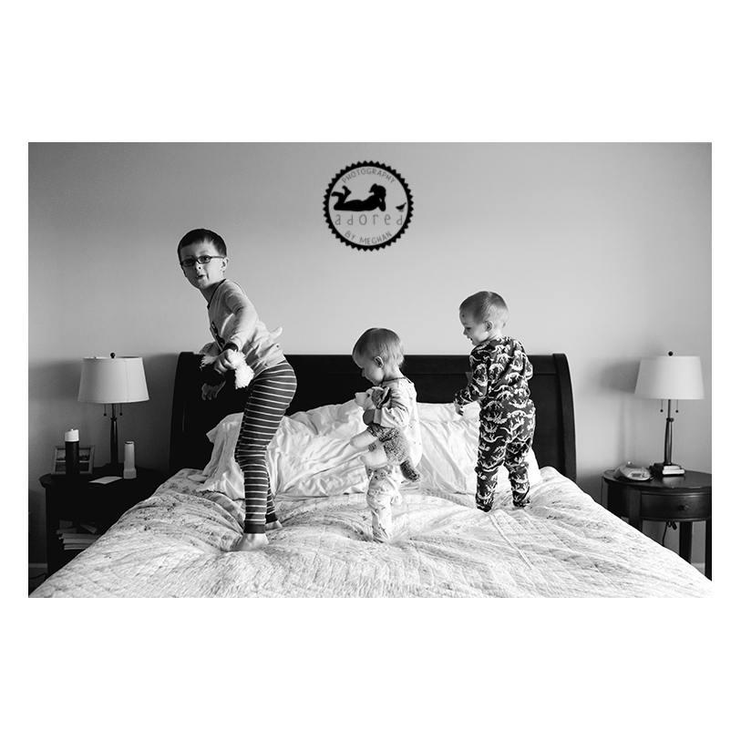 Three little monkeys jumping on the bed. Lifestyle in-home photos done by Adored by Meghan, Kennewick, WA.