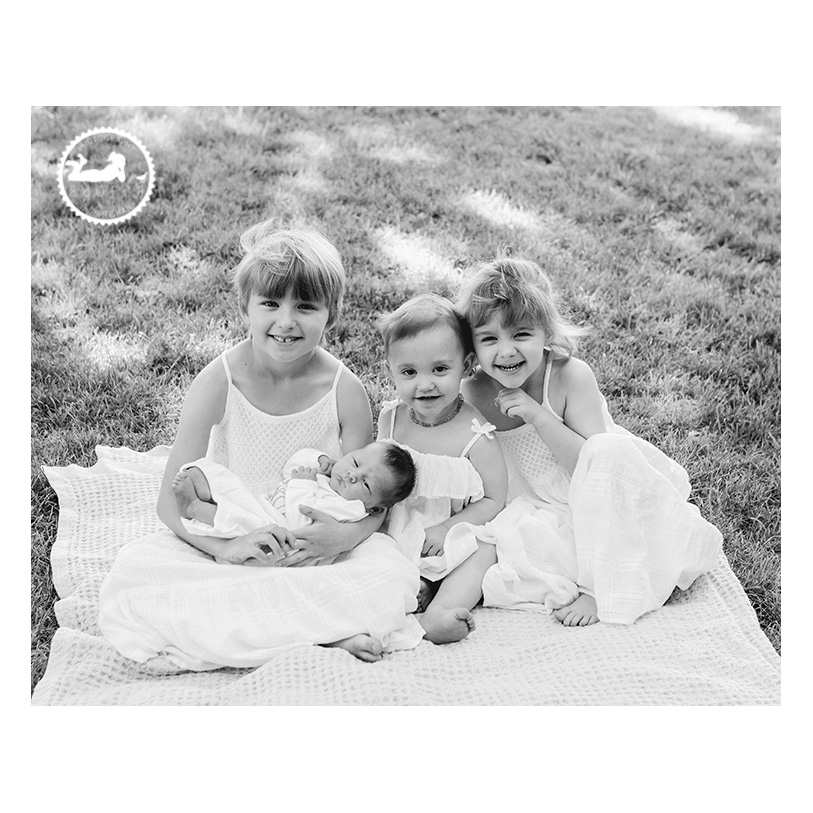 Beautiful sisters with their new baby sister. Classic black and white portrait by Adored by Meghan out of Kennewick, WA.