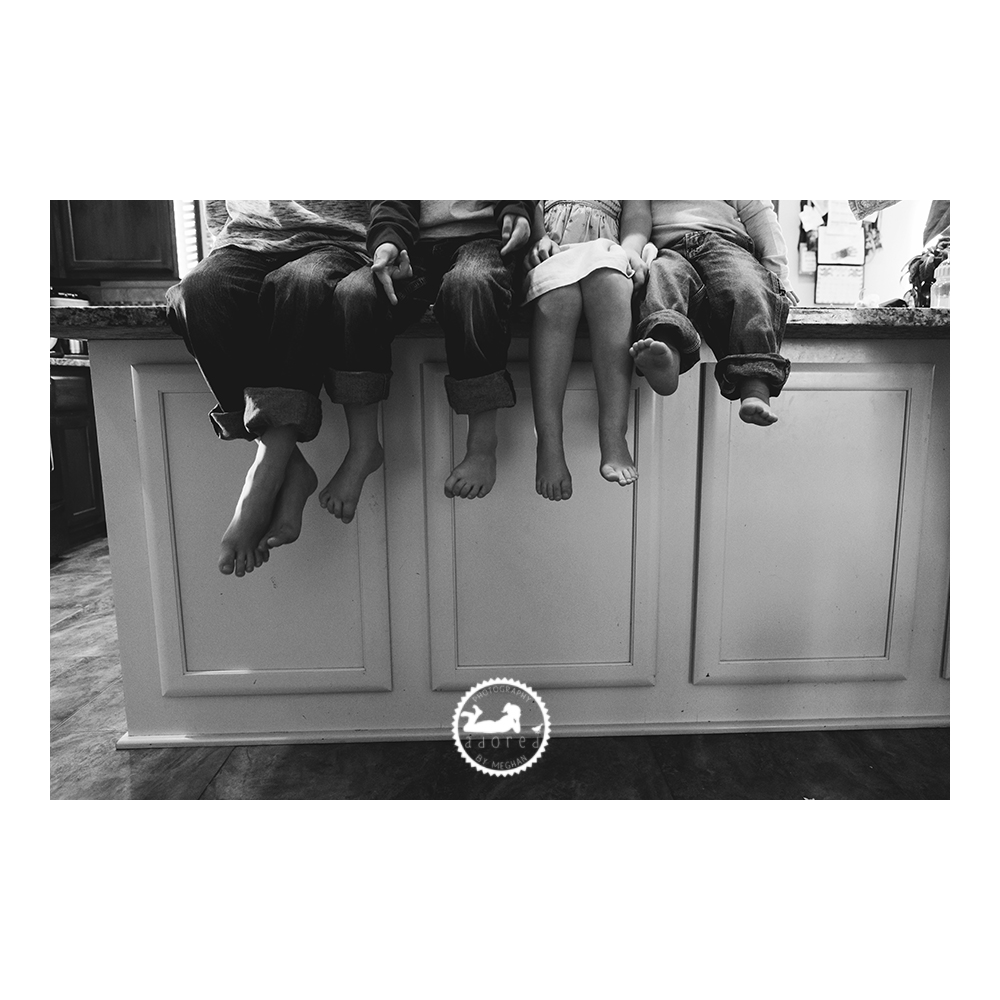 When having a professional portrait session, keep in mind capturing some photos that can be recreated as the years go by, that show the growth of your family. Adored by Meghan does just that in this photo of siblings sitting close together on their kitchen island, with their feet dangling over the side, showing the sizes of the kids. Adored by Meghan is a lifestyle photographer, Pasco, WA.