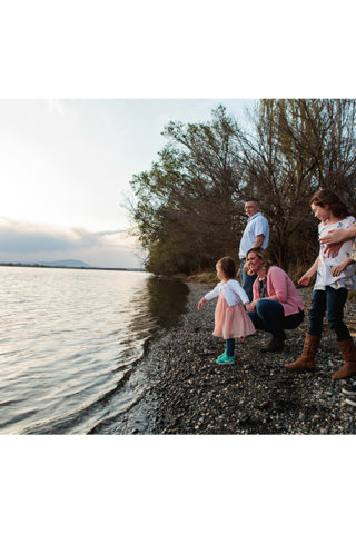 Throwing rocks in the Columbia River at Chiawana Park in Pasco, WA. Portraits by Adored by Meghan, Tri-Cities, WA.