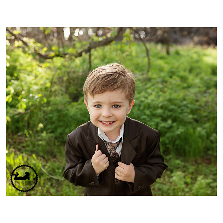 Handsome little boy in jacket and tie for his photos, by Adored by Meghan