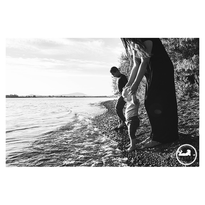 Black and white photo of Mother and two boys down at the riverside
