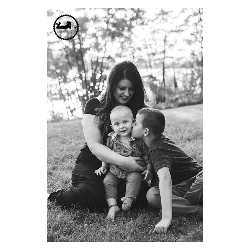 Photo of Mother and two sons in black and white by the Columbia River