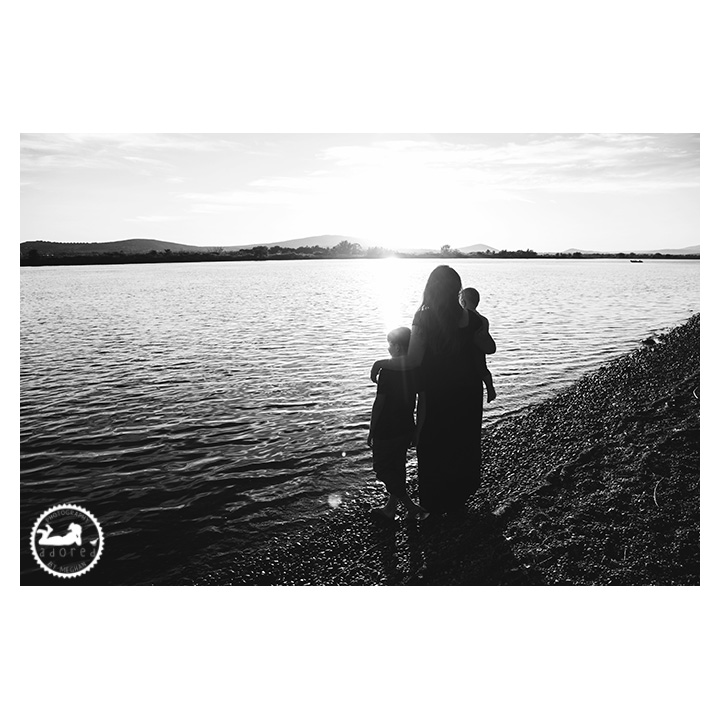 Black and white silhouette photo of a Mother and her two children, at sunset on the Columbia River, Pasco, WA