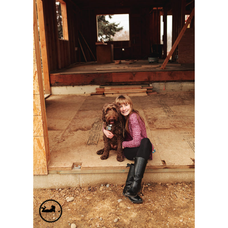 Getting photos taken during a house rebuild.  Doddle pup is a part of the family.